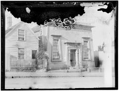 Photograph of Hobart Synagogue with a long-demolished house next door.